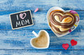 Breakfast with coffee and bun Heart. Letter I love mom Royalty Free Stock Photo