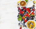Breakfast with coffee, corn flakes, milk  and berry Royalty Free Stock Photo