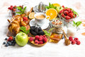 Breakfast with coffee, croissants, muesli, berries, fruits Royalty Free Stock Photo