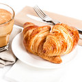 Breakfast with coffee cup and croissants on a plate and linen n napkin isolated white background closeup Royalty Free Stock Images