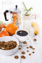Breakfast with coffee, muesli and fruits over white wooden backg Royalty Free Stock Photo