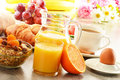 Breakfast with coffee orange juice croissant egg vegetables and fruits Stock Images