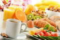 Breakfast with coffee orange juice croissant egg vegetables and fruits Royalty Free Stock Photo