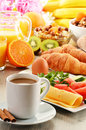 Breakfast with coffee orange juice croissant egg vegetables and fruits Royalty Free Stock Photos