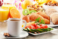 Breakfast with coffee orange juice croissant egg vegetables and fruits Stock Image