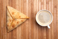 Breakfast from coffee and pie samsa on a wooden mat Stock Photos