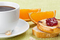 Breakfast with coffee toast cherry jam and orange segment Stock Photo