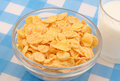 Breakfast corn flakes in a transparent bowl with milk Stock Photos