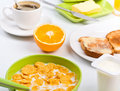Breakfast with cornflakes,toast, orange and coffee Stock Photos
