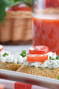 Breakfast of cottage cheese bruschettas and vegetable basket sandwiches with tomato dill on the kitchen table Royalty Free Stock Photos