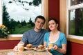 Breakfast couple eating home Στοκ Φωτογραφίες