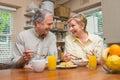 Breakfast couple having senior together 免版税图库摄影