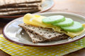 Breakfast with crispbread close up of slices cheese and cucumber Royalty Free Stock Photo