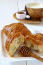 Breakfast with croissant honey and milk on light background Stock Image