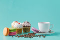 Breakfast with cupcakes and french macaroons Royalty Free Stock Photo