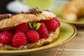 Breakfast detail french with croissant coffee and raspberries Royalty Free Stock Photography