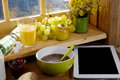 Breakfast with digital tablet, near the window Royalty Free Stock Photo