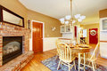 Breakfast dining room area with fireplace near kitchen american farm house brick Stock Photos
