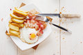 Breakfast with eggs, bacon, French fries and coffee top view Royalty Free Stock Photo