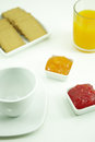 Breakfast an empty cup with biscuits orange juice and marmelade Stock Image