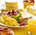 Breakfast food with scrambled eggs sausage links and toast Stock Photos
