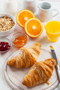 Breakfast with French croissants Royalty Free Stock Photo