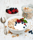 Breakfast with fresh berries on a wooden table Royalty Free Stock Photo
