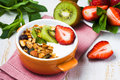 Breakfast with  fresh Greek yogurt, strawberries, kiwi and grano Royalty Free Stock Photo