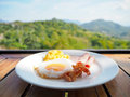 Breakfast with fried egg,ham bacon and scrambled egg Royalty Free Stock Photo