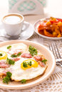 Breakfast with fried eggs vertical Royalty Free Stock Photo