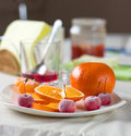 Breakfast with frozen fruits and orange Stock Images