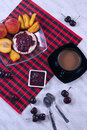 Breakfast with fruit a light peaches cherries loaf butter and jam coffee Royalty Free Stock Image