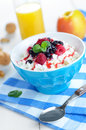 Breakfast with fruits cottage cheese in blue bowl raspberries blueberries and mint Stock Photography