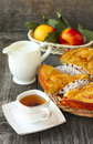 Breakfast with homemade peach pie tea milk and fruit fresh Stock Images