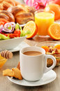 Breakfast including coffee, bread, honey, orange juice, muesli Stock Photos