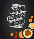 Breakfast menu drawing with chalk on blackboard croissants coffee and juice Royalty Free Stock Images
