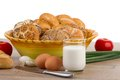 Breakfast menu - fresh buns, milk, eggs and tomatoes Royalty Free Stock Photo