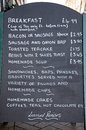 Breakfast menu lichfield chalkboard on the pavement in the city centre staffordshire england western europe Royalty Free Stock Photo