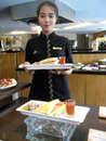 Breakfast menu waitres show at a hotel do city of solo central java indonesia Stock Image