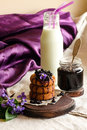 Breakfast with milk, cookies and jam Royalty Free Stock Photo