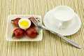 Breakfast milk egg and tomato the color is very beautiful the taste is very delicious also nutritious food Stock Photography