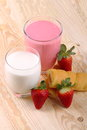Breakfast with milk strawberry smoothie and afternoon snack glass of on wood of fir Stock Images