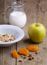 Breakfast with muesli, milk and apple Royalty Free Stock Photo