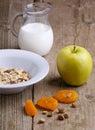 Breakfast with muesli, milk and apple Royalty Free Stock Photo