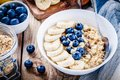 Breakfast: oatmeal with bananas, blueberries, chia seeds and almonds Royalty Free Stock Photo