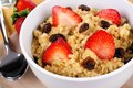 Breakfast oatmeal close up of cereal with strawberries and raisins Royalty Free Stock Image