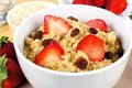 Breakfast oatmeal close up of cereal with strawberries and raisins Stock Photography