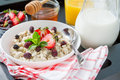 Breakfast - oatmeal with honey and berries, blue bowl Royalty Free Stock Photo