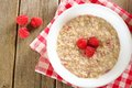 Breakfast oatmeal with raspberries overhead view Royalty Free Stock Photo