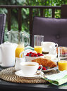 Breakfast on the open terrace Royalty Free Stock Photo